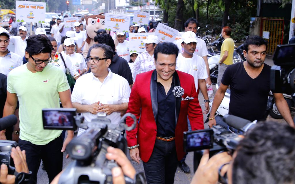 Dr. Bhupendra Avasthi, actor Govinda and singer Shaan during the walkathon organized by Surya Sunshine Child Care Hospital on the occasion of Children's Day in Mumbai, on Nov. 14, 2014.