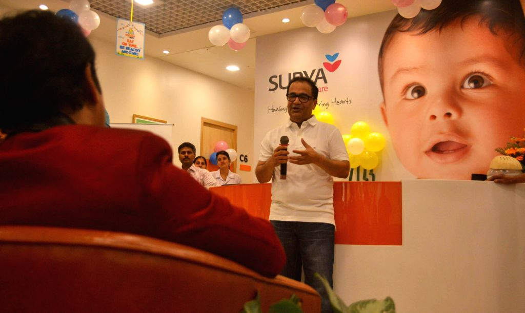 Dr. Bhupendra Avasthi during the walkathon organized by Surya Sunshine Child Care Hospital on the occasion of Children's Day in Mumbai, on Nov. 14, 2014.