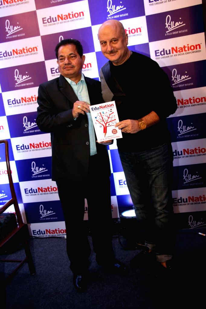 Dr. K. M. Vasudevan Pillai, CEO of Mahatma Education Society and actor Anupam Kher during the launch of Vasudevan Pillai`s book EduNation, in Mumbai on January 31, 2015. - Anupam Kher