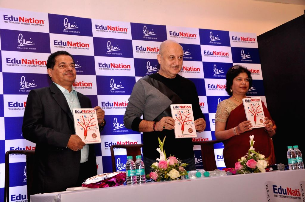 Dr. K. M. Vasudevan Pillai, CEO of Mahatma Education Society, actor Anupam Kher and Dr. Daphne Pillai, co-founder of the Pillai Group, during the launch of Vasudevan Pillai`s book EduNation, . - Anupam Kher