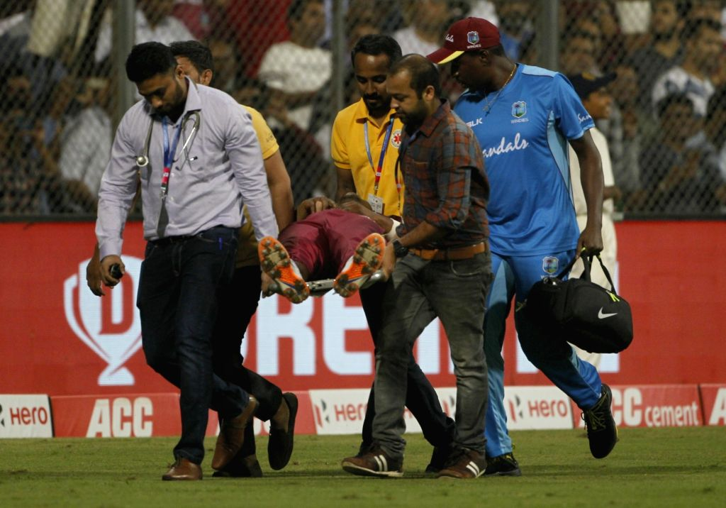 Mumbai: Evin Lewis of West Indies being taken for medical examination and treatment after he got injured during the third T20I match between India and West Indies at Wankhede Stadium in Mumbai on Dec 11, 2019. (Photo: Surjeet Yadav/IANS) - Surjeet Yadav