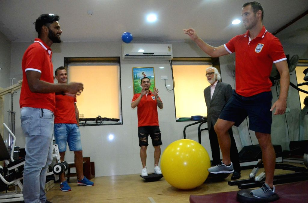 Mumbai FC football team players Albino Gomes, Lucian Goian, Maties Defederico, Dr. P Doshi and Krisztian Vadocz participate physiotherapy session in Mumbai on Aug 13, 2016.