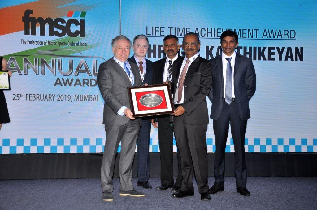 Mumbai: FIA President Jean Todt, Raymond Group CMD Gautam Singhania, FMSCI President J. Prithiviraj, former president of FMSCI (1981-82 & 1985-87), G.R. Karthikeyan honoured with the Lifetime Achievement Award, India's first Formula One driver Narain - Narain Karthikeyan