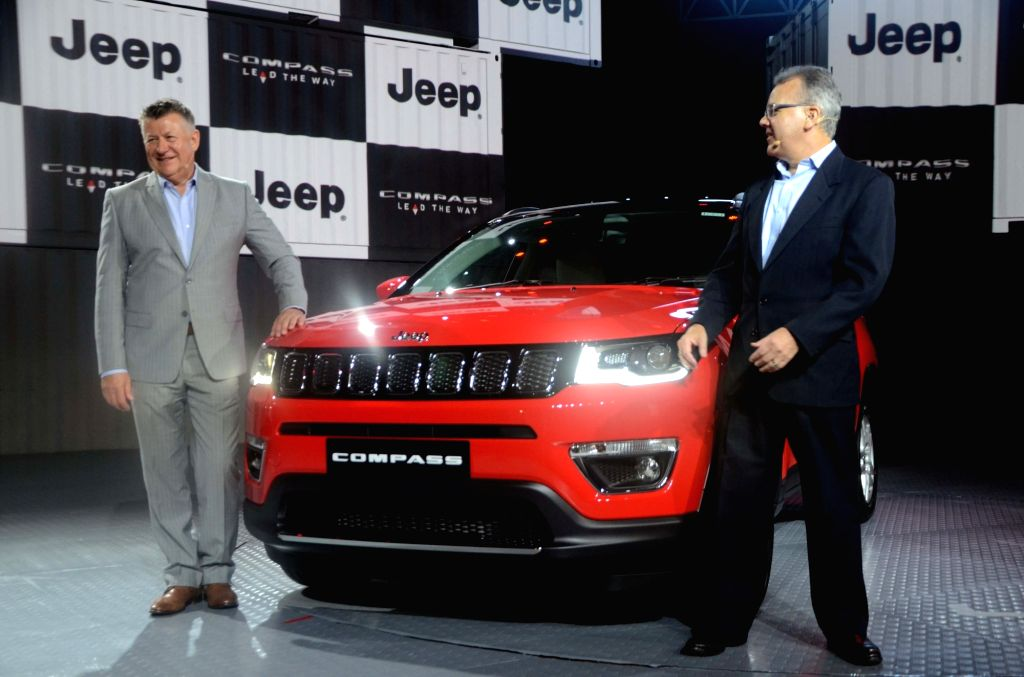 Mumbai: Fiat Chrysler Automobile (FCA) India President and Managing Director Kevin Flynn and FCA COO-Asia Pacific Paul Alcala at the launch of Jeep Compass SUV in Mumbai on July 31, 2017. (Photo: IANS)