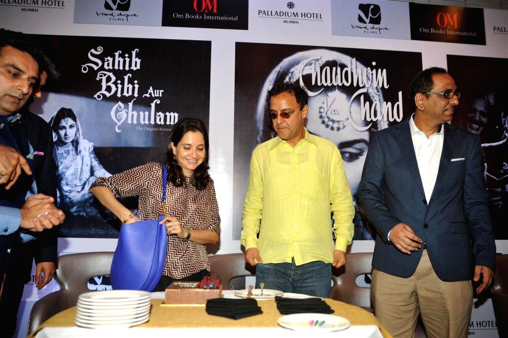 Film Critic Anupama Chopra celebrates her birthday with husband filmmaker Vidhu Vinod Chopra at the launch of filmmaker Guru Dutt's film screenplays books in Mumbai on Feb 23, 2015. - Critic Anupama Chopra and Dutt