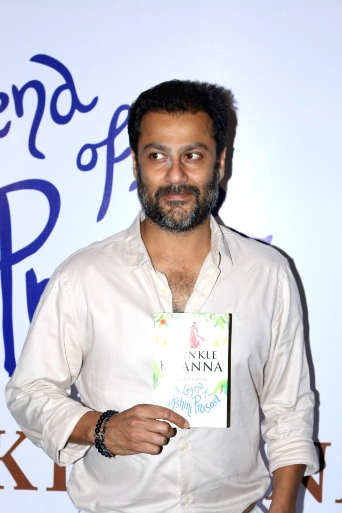 Mumbai: Filmmaker Abhishek Kapoor during the launch of book, The Legend of Lakshmi Prasad, a collection of four short stories by author Twinkle Khanna, in Mumbai, on Nov 15, 2016. (Photo: IANS) - Abhishek Kapoor and Khanna