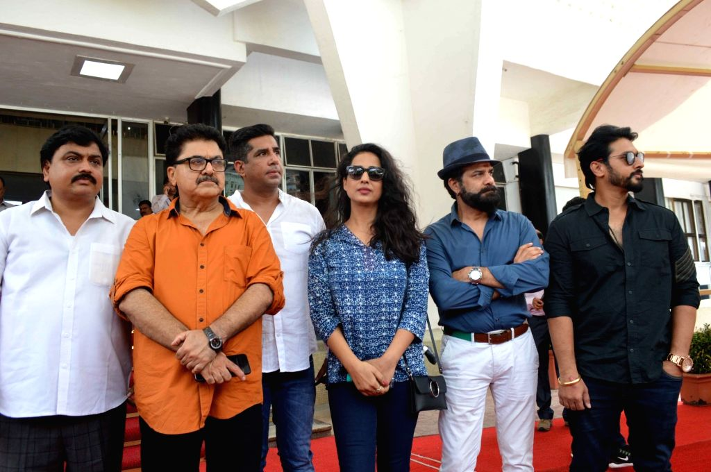 Mumbai: Filmmaker Ashoke Pandit and actress Mahie Gill arrive to meet Maharashtra Chief Minister Devendra Fadnavis regarding an attack on the latter at Thane's Ghodbunder Road, in Mumbai on June 20, 2019. Four unidentified goons entered a set at Than - Ashoke Pandit