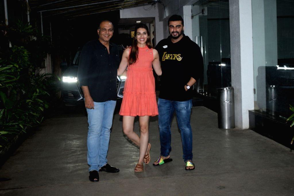 Mumbai: Filmmaker Ashutosh Gowarikar and actors Arjun Kapoor and Kriti Sanon seen at a recording studio in Mumbai's Juhu on Aug 16, 2019. (Photo: IANS) - Ashutosh Gowarikar, Arjun Kapoor and Kriti Sanon