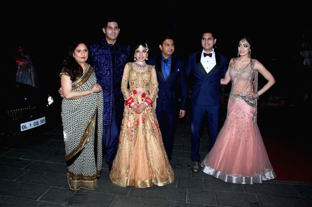 Filmmaker Bhushan Kumar with his family during the wedding reception of Tulsi Kumar and Hitesh in Mumbai on March 2, 2015. - Bhushan Kumar