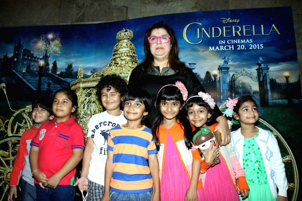 Filmmaker Farah Khan along with her children during the special screening of film Cinderella in Mumbai on March 13, 2015. - Farah Khan