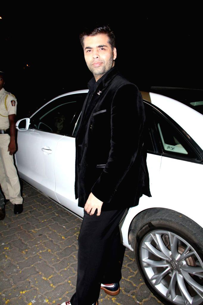 Filmmaker Karan Johar arrive for actor Anil Kapoor`s get-together to share the trailer of the film Dil Dhadakne Do, in Mumbai on 13th April 2015. - Karan Johar