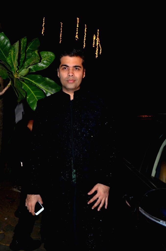 :Mumbai: Filmmaker Karan Johar arrives to attend the bollywood Akshay Kumar`s Diwali party in Mumbai on Nov 9, 2015. (Photo: IANS). - Karan Johar and Rukh Khan