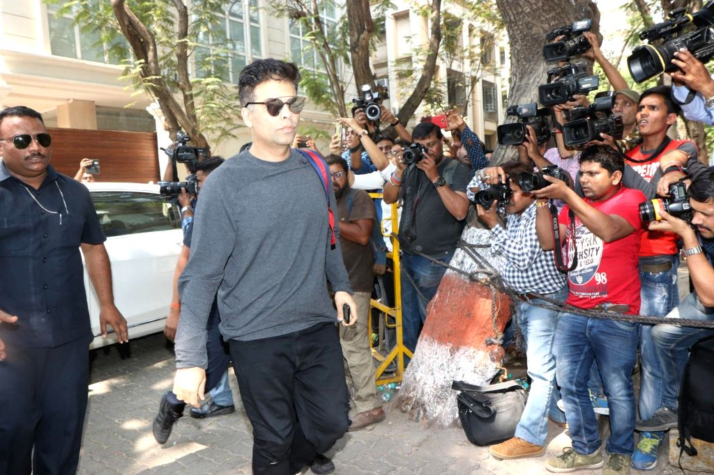 Mumbai: Filmmaker Karan Johar at actor Anil Kapoor's residence to meet the grief struck Kapoor family after sudden demise of actress Sridevi, in Mumbai on Feb 26, 2018. Veteran actress Sridevi passed away on Saturday night after suffering a cardiac a - Karan Johar, Sonam Kapoor and Khushi Kapoor