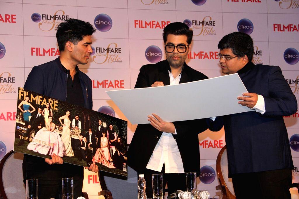 Filmmaker Karan Johar, fashion designer Manish Malhotra and Filmfare editor Jitesh Pillai during the cover launch of Ciroc Filmfare Glamour and Style Awards issue in Mumbai on March 30, 2015. - Karan Johar and Manish Malhotra