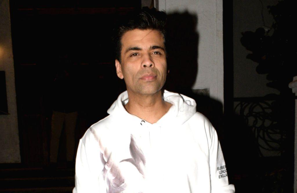 Mumbai: Filmmaker Karan Johar seen at a restaurant in Mumbai's Bandra, on March 22, 2019. (Photo: IANS) - Karan Johar