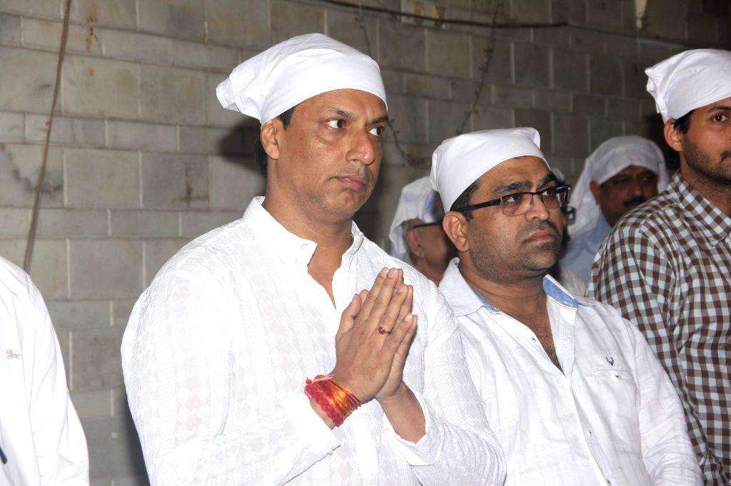 Filmmaker Madhur Bhandarkar during the condolence meeting of his mother Shanta Bhandarkar in Mumbai on Feb 23, 2015.