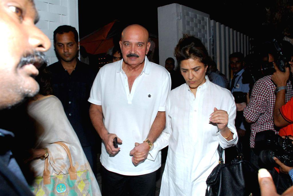 Filmmaker Rakesh Roshan with his wife during the condolence meeting organised in the memory of late filmmaker Ravi Chopra in Mumbai, on Nov 15, 2014. - Rakesh Roshan