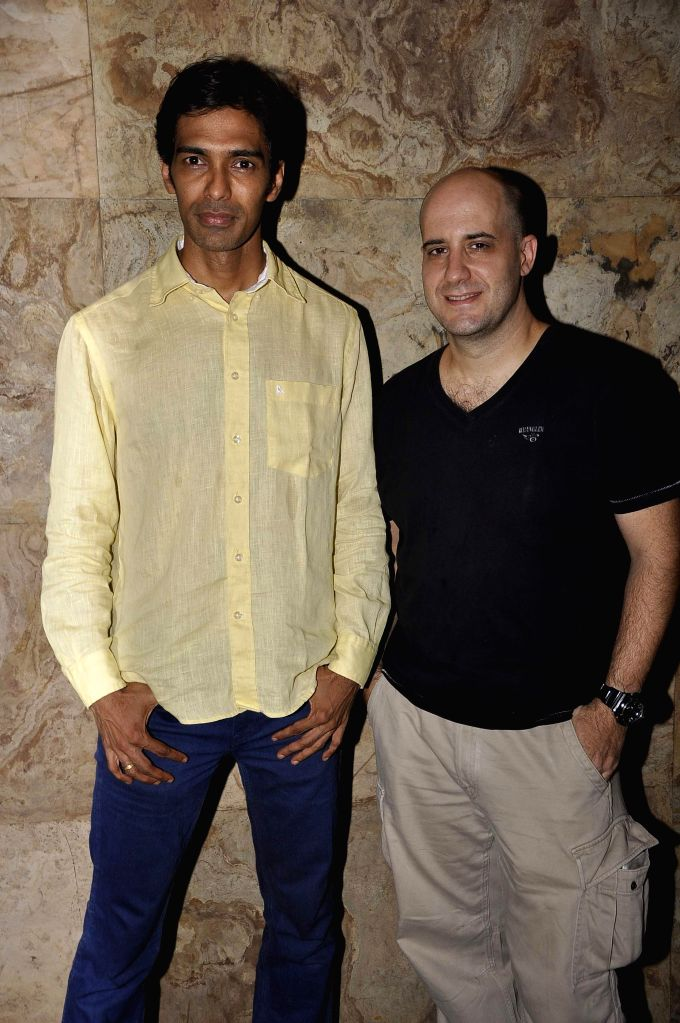 Filmmaker Sandeep Mohan (L) with actor Ashwin Mushran during the premier of Bollywood movie Hola Venky. The movie by independent filmmaker Sandeep Mohan, made at a cost of INR 10 Lakh or US$ ... - Sandeep Mohan