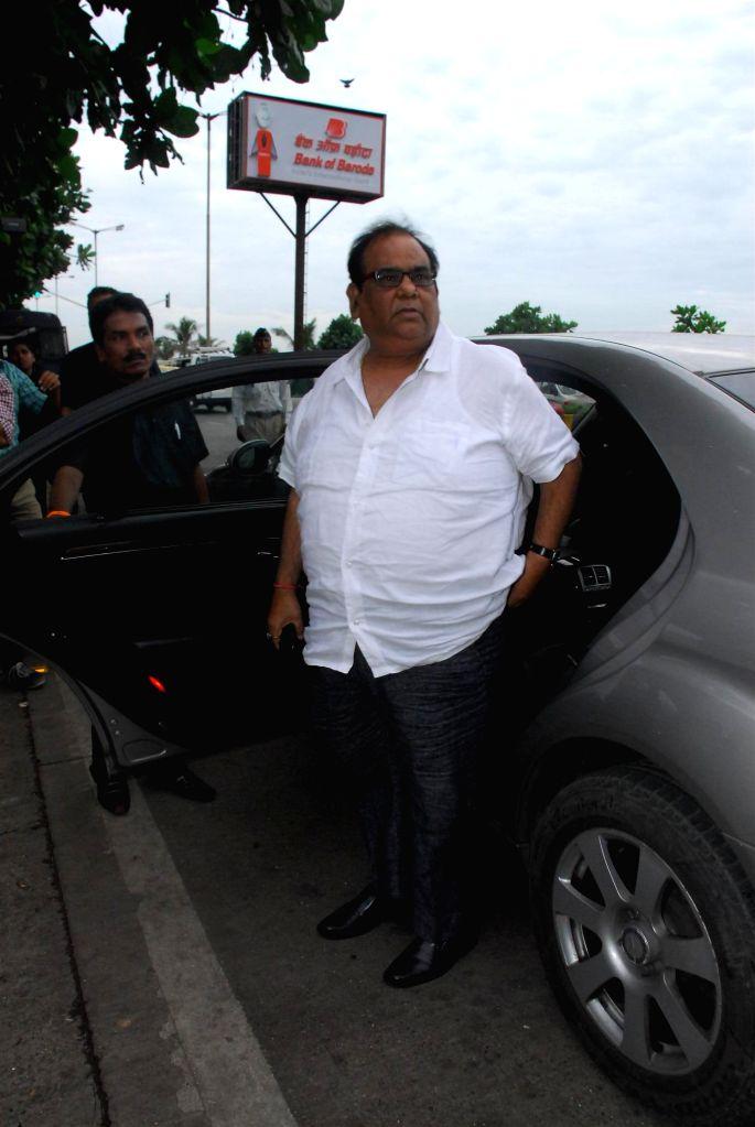 Filmmaker Satish Kaushik during the condolence meeting organised in the memory of late filmmaker Ravi Chopra in Mumbai, on Nov 15, 2014. - Satish Kaushik