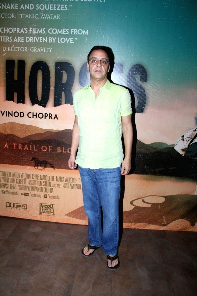 Filmmaker Vidhu Vinod Chopra during the special screening of Hollywood film Broken Horses in Mumbai on March 30, 2015. - Vidhu Vinod Chopra