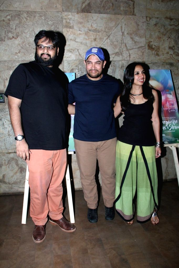 Filmmakers Nilesh Maniyar and Sonali Bose with actor Aamir Khan during the special screening of film Margarita With A Straw in Mumbai on April 8, 2015. - Aamir Khan, Nilesh Maniyar and Sonali Bose