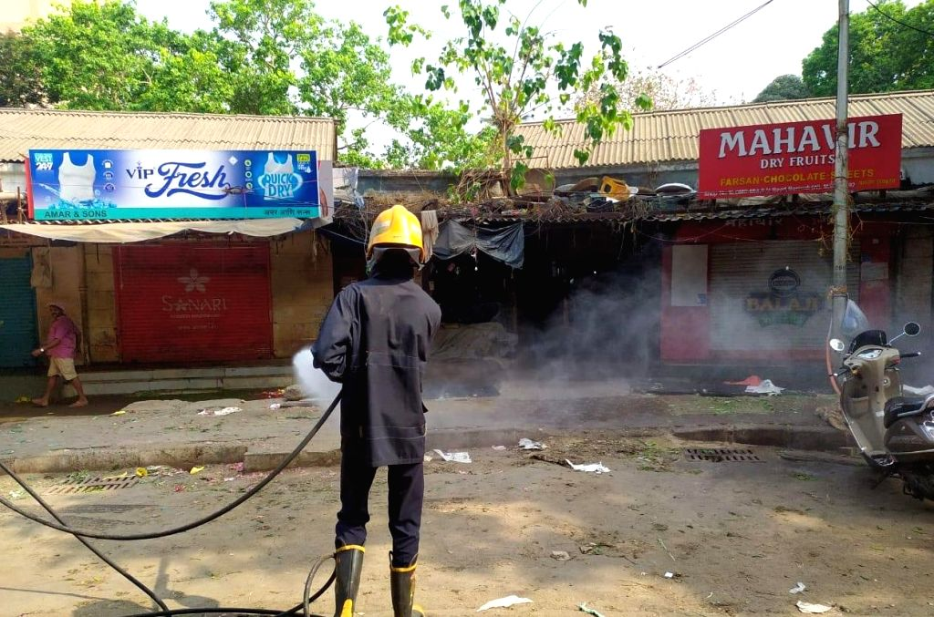 Mumbai Fire Brigade personnel spray chemicals in major civic hospitals and important civic markets to combat the Coronavirus pandemic amid 21-day long national lockdown, on March 25, 2020. In a rare operation, the Mumbai Fire Brigade has been deploye