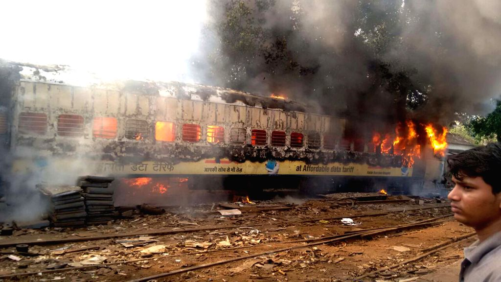 Firefighters douse a fire that broke out in a train coach at a Matunga railway yard in Mumbai on May 5, 2015.