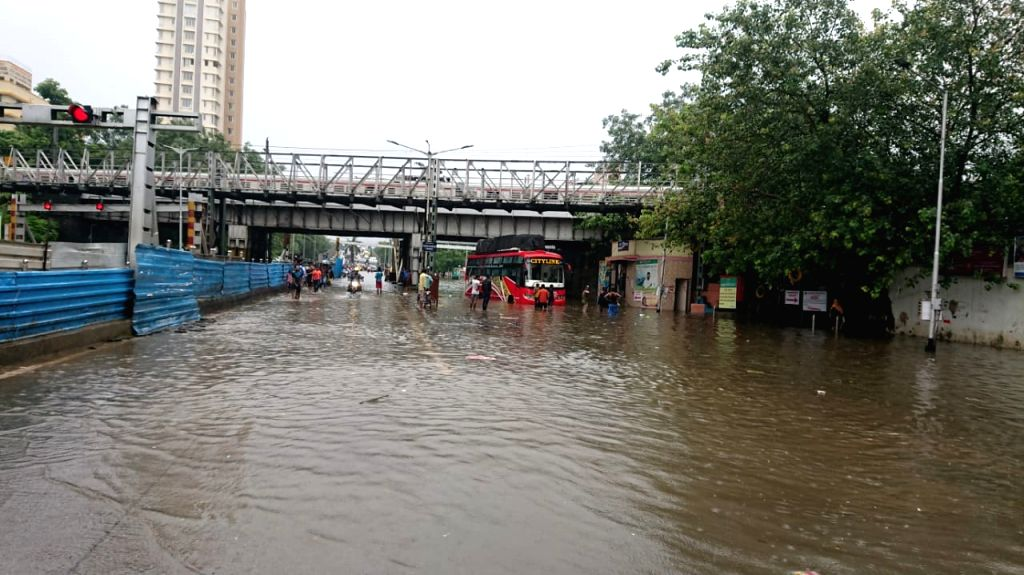 Mumbai: Flooded streets of Mumbai on July 2, 2019. The Maharashtra government declared a precautionary public holiday on Tuesday in Mumbai after the Central Railway (CR) suspended services at several spots between Mumbai-Thane and suburban train serv