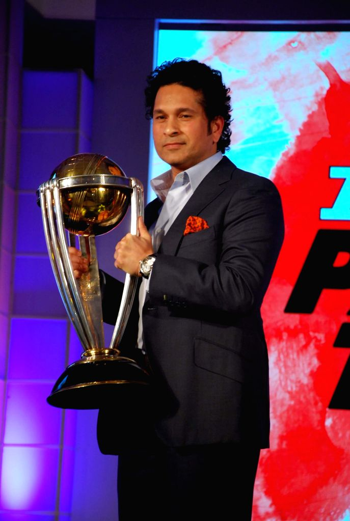 Former Indian cricketer and brand ambassador of the International Cricket Council's (ICC) Cricket World Cup 2015 Sachin Tendulkar holds the ICC Cricket World Cup 2011 trophy during a ...