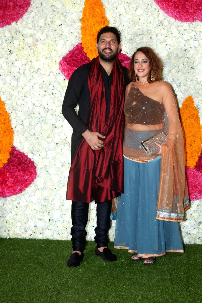 Mumbai: Former Indian cricketer Yuvraj Singh with his wife Hazel Keech at a Diwali party hosted by Reliance Industries Chairman Mukesh Ambani and his wife Nita Ambani in Mumbai on Oct 24, 2019. (Photo: IANS) - Yuvraj Singh, Mukesh Ambani and Nita Ambani