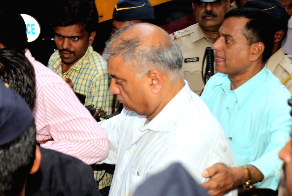 :Mumbai: Former media tycoon Peter Mukerjea, who has been arrested in connection with the murder of his step-daugther Sheena Bora, after being produced at a Mumbai Court on Nov 20, 2015. (Photo: ...