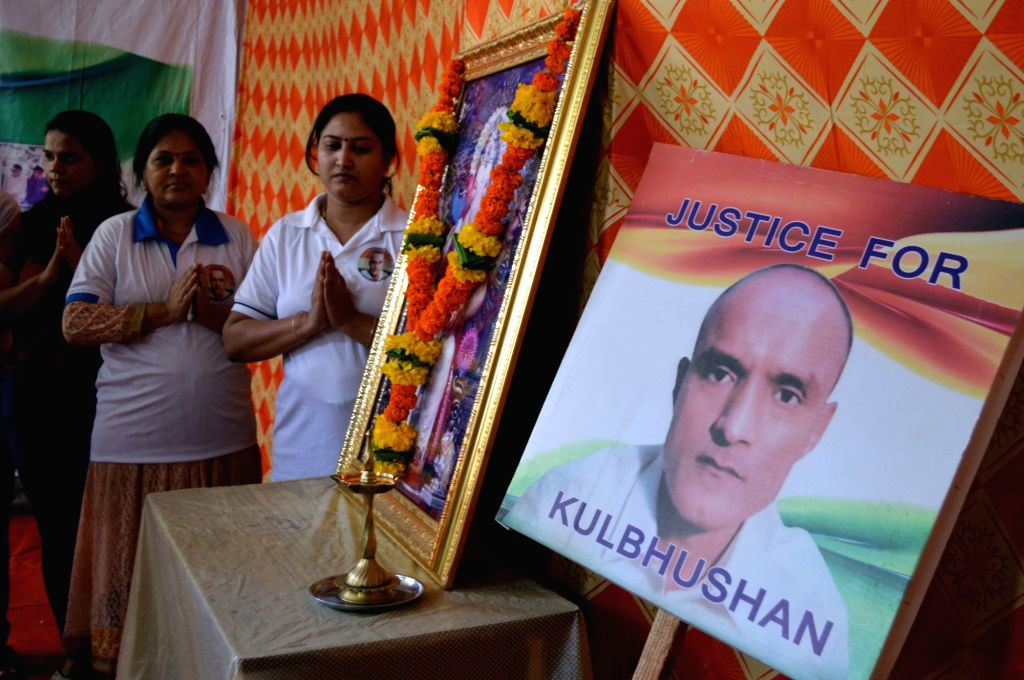 Mumbai: Friends of Kulbhushan Jadhav, a Mumbaikar who is facing death sentence in Pakistan, pray for his release, in Mumbai on July 17, 2019. The International Court of Justice (ICJ) will deliver its judgement on Wednesday evening on India's petition