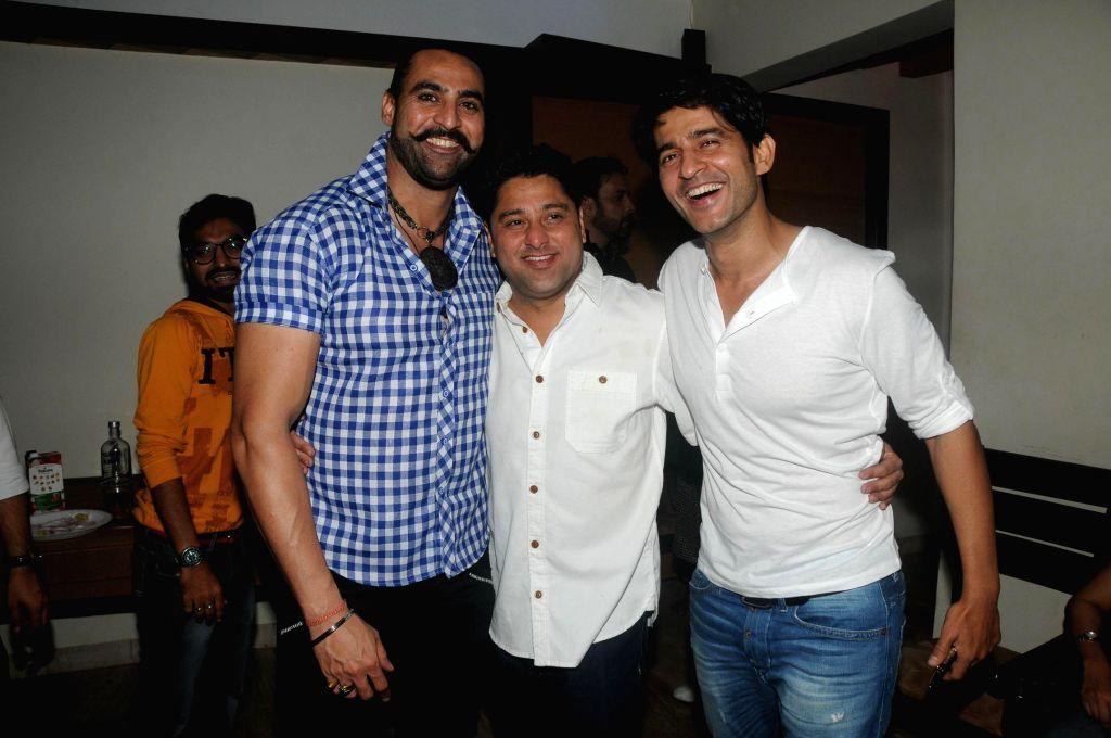 Harry Josh, Kaushik Banerjee with Hiten Tejwani during the birthyday of director Kaushik Banerjee in Mumbai on Jan 10, 2015.