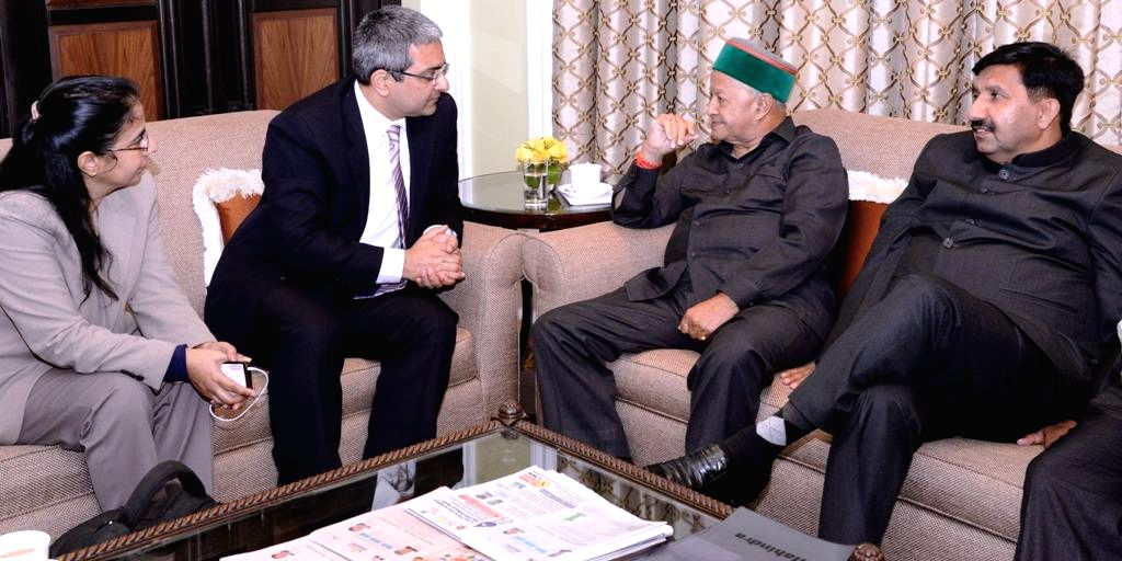 Himachal Chief Minister Virbhadra Singh interacts with the representatives of Tata group in Mumbai, on Nov 5, 2014. - Virbhadra Singh