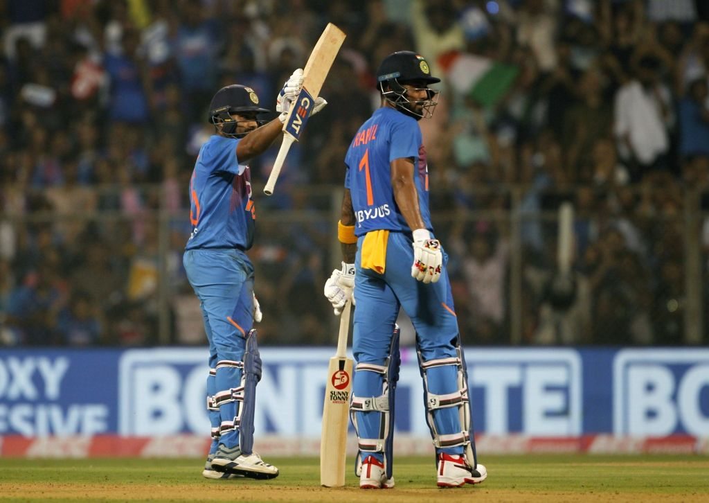 Mumbai: India's Rohit Sharma celebrates his half century with teammate Lokesh Rahul during the third T20I match between India and West Indies at Wankhede Stadium in Mumbai on Dec 11, 2019. (Photo: Surjeet Yadav/IANS) - Rohit Sharma, Lokesh Rahul and Surjeet Yadav