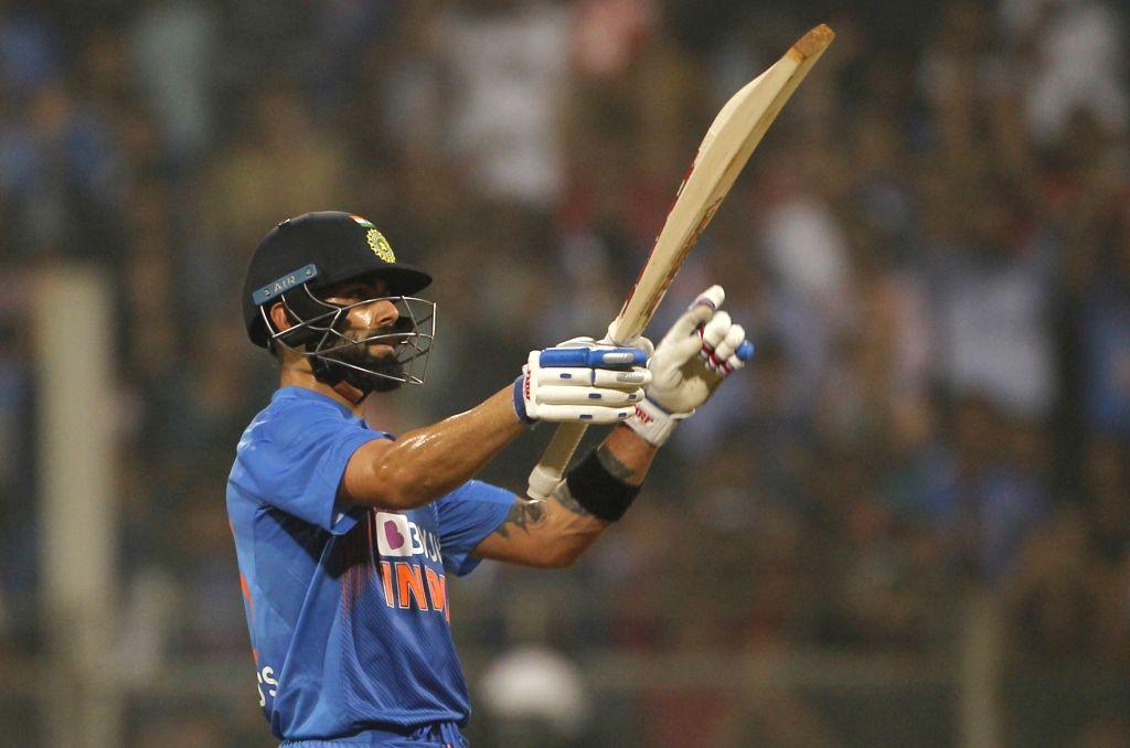 Mumbai: Indian Captain Virat Kohli in action during the third T20I match between India and West Indies at Wankhede Stadium in Mumbai on Dec 11, 2019. (Photo: Surjeet Yadav/IANS) - Virat Kohli and Surjeet Yadav