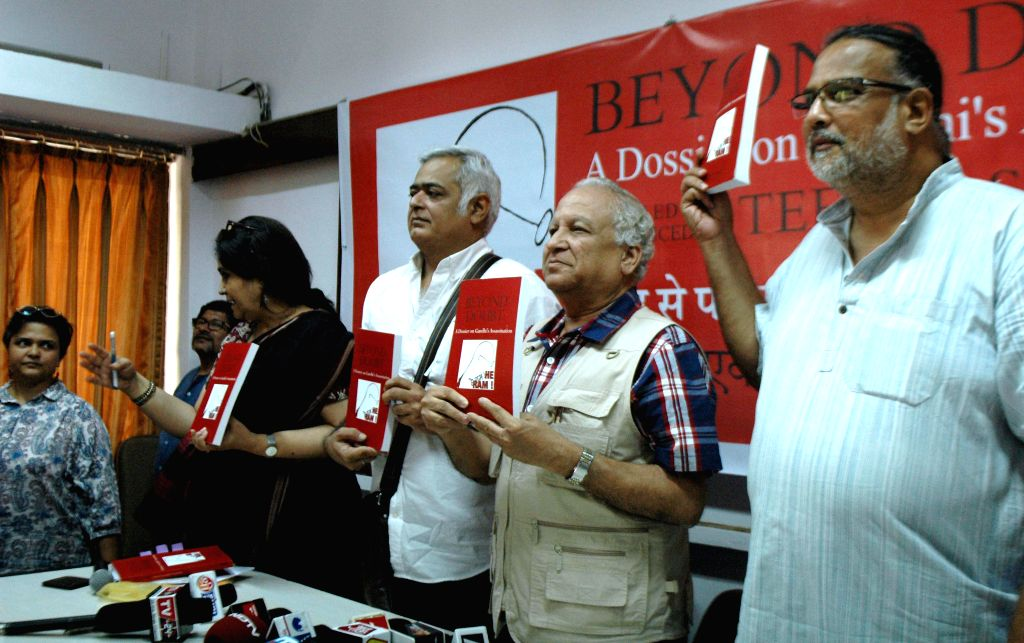 Indian civil rights activist Teesta Setalvad, filmmaker Hansal Mehta, journalist Kumar Ketkar and the great-grandson of Mahatma Gandhi at the launch of a dossier on Mahatma Gandhi's ... - Hansal Mehta