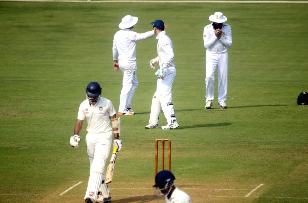 Mumbai: Indian cricketer Naman Ojha walks back to the pavilion after his dismissal during a match between Indian Board President`s XI and South African at Brabourne Stadium in Mumbai on Oct ...