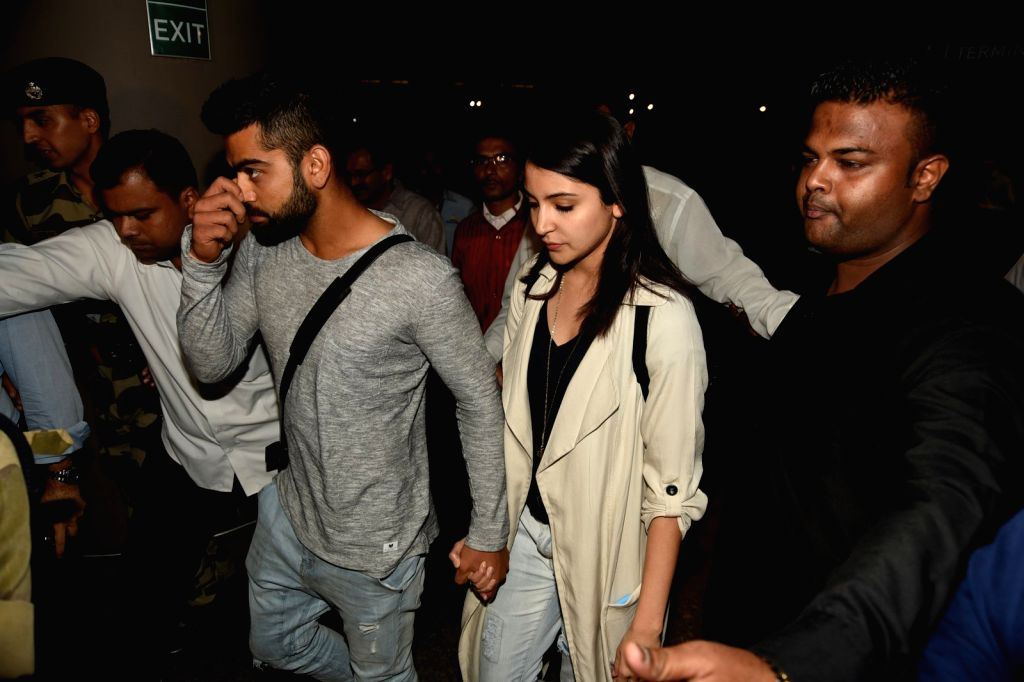 Indian cricketer Virat Kohli and Bollywood actress Anushka Sharma arrive from Australia with the Indian cricket team, at the Chhatrapati Shivaji International Airport, in Mumbai on March 27, ...
