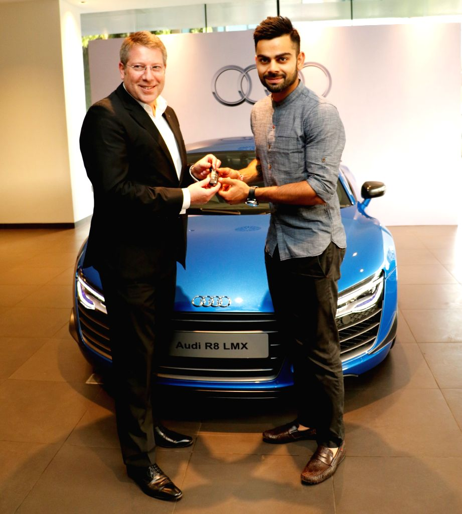 Indian Cricketer Virat Kohli and Joe King, Head Audi India  takes delivery of the limited edition Audi R8 LMX super sports car in Mumbai on  7th May, 2015 - Cricketer Virat Kohli