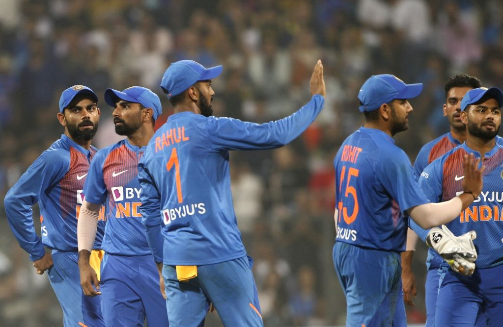 Mumbai: Indian players celebrate the wicket of West Indies batsman Lendl Simmons during the third T20I match between India and West Indies at Wankhede Stadium in Mumbai on Dec 11, 2019. (Photo: Surjeet Yadav/IANS) - Lendl Simmons and Surjeet Yadav