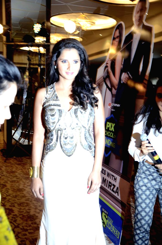 Indian tennis player Sania Mirza on the sets of `Pix school of Bonding` in Mumbai on Nov. 20, 2014. Sony PIX will celebrate the Bond Fest with back to back Bond movies starting from 22 ...