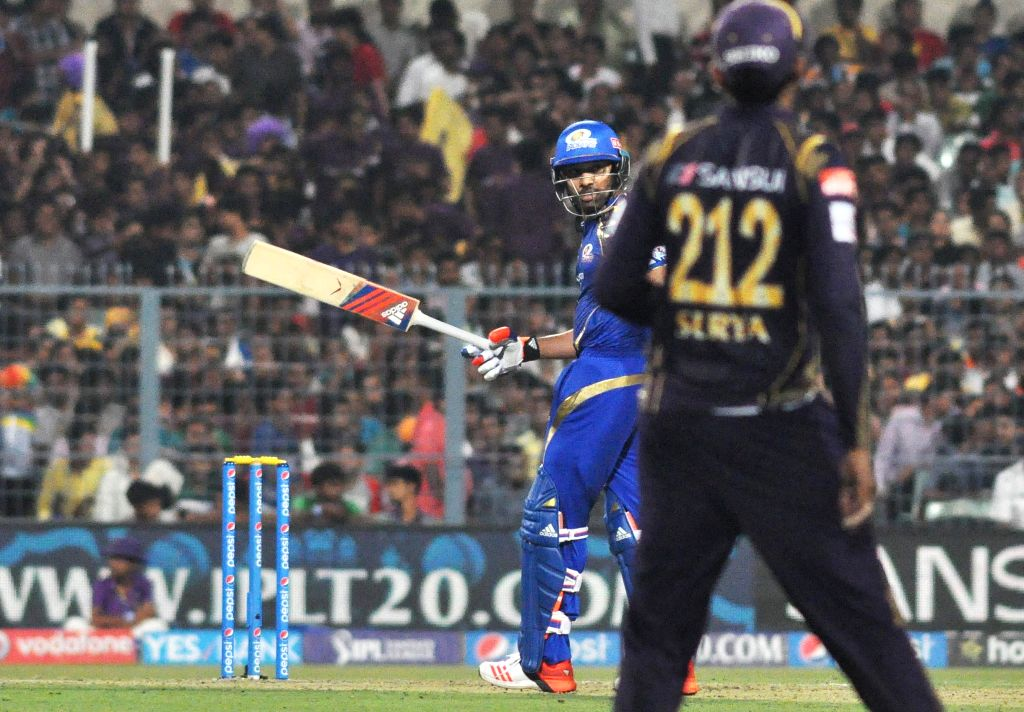 Mumbai Indians batsman Rohit Sharma celebrates after scoring half century during an IPL-2015 match between Kolkata Knight Riders and Mumbai Indians in Kolkata, on April 8, 2015. - Rohit Sharma