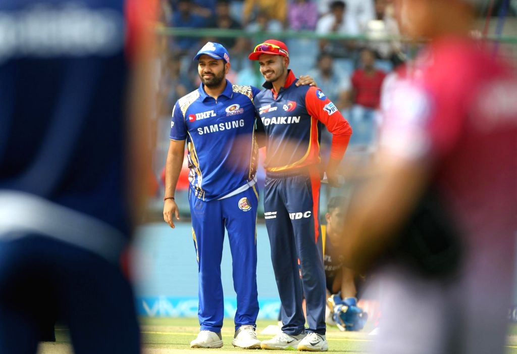 Mumbai Indians captain Rohit Sharma and Delhi Daredevils captain Shreyas Iyer during the toss ahead of an IPL 2018 match between Delhi Daredevils and Mumbai Indians at Feroz Shah Kotla ... - Rohit Sharma