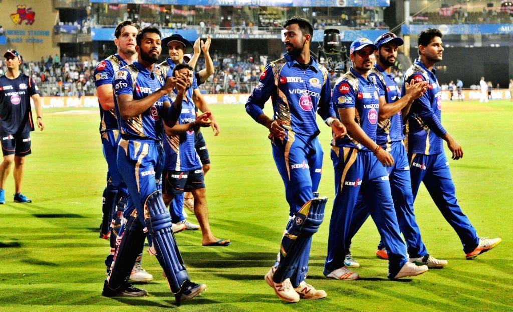 Mumbai Indians celebrate after winning an IPL 2017 match between Mumbai Indians and Gujarat Lions at Wankhede Stadium in Mumbai on April 16. 2017.