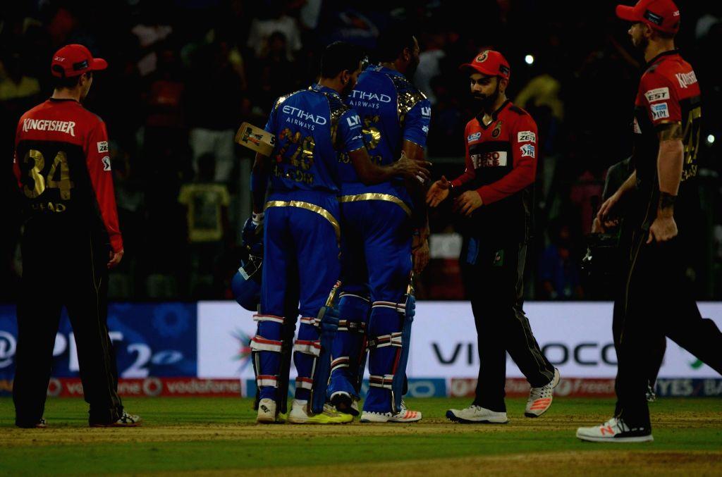 Mumbai Indians celebrate after winning the IPL match against Royal Challengers Bangalore at Wankhede Stadium in Mumbai on April 20, 2016.