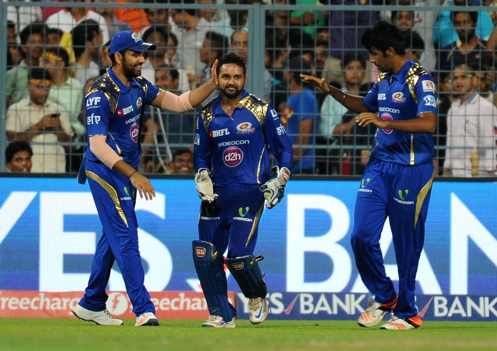Mumbai Indians celebrate fall of a wicket during an IPL match between Kolkata Knight Riders and Mumbai Indians at the Eden Gardens in Kolkata, on April 13, 2016.