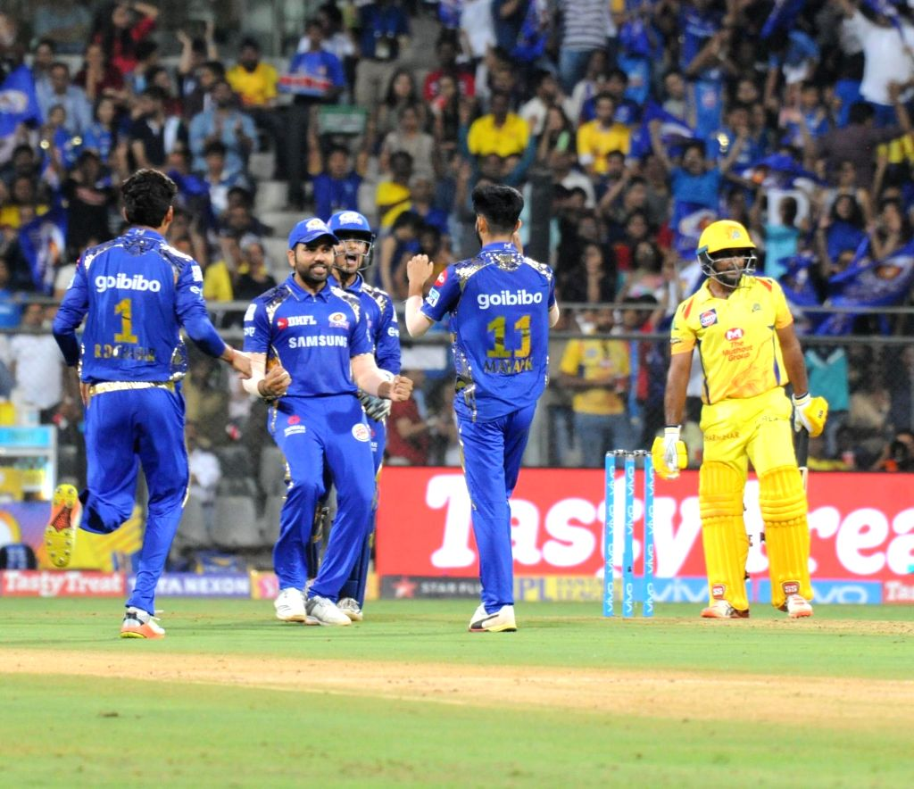 Mumbai Indians celebrate fall of a wicket during an IPL 2018 match between Mumbai Indians and Chennai Super Kings at Wankhede Stadium in Mumbai on April 7, 2018.