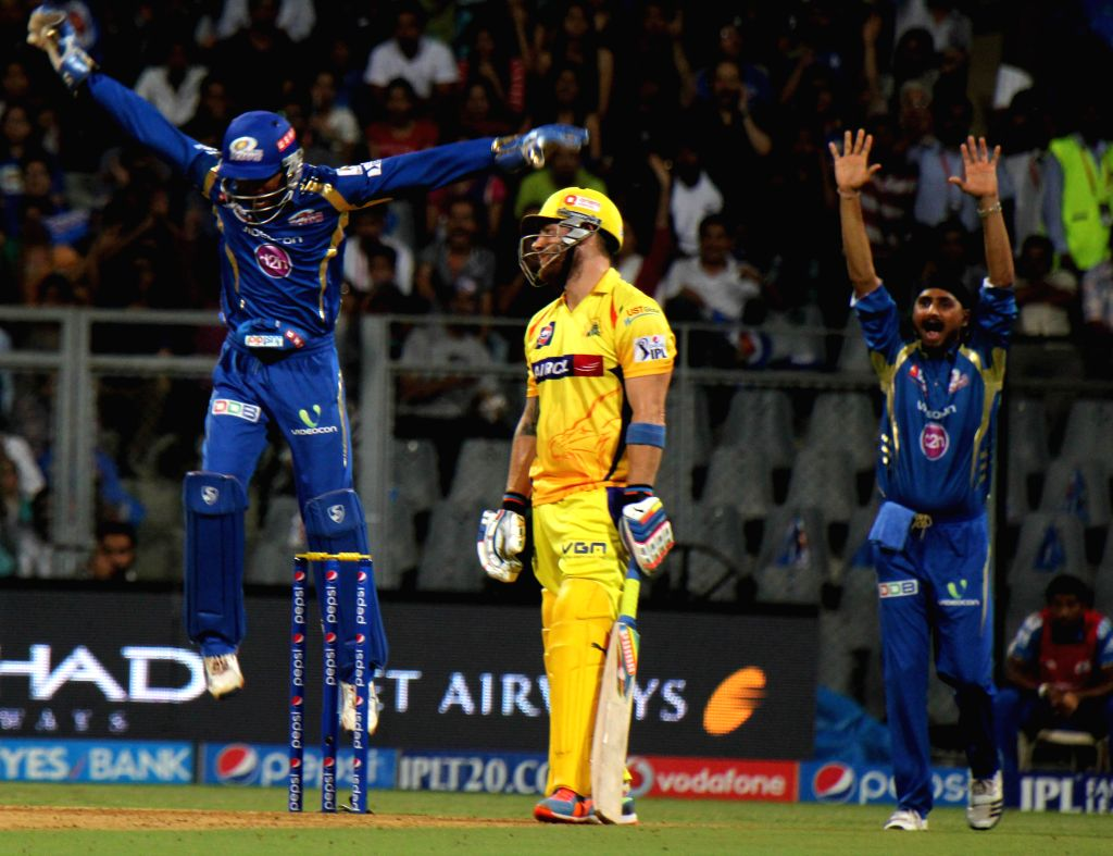 Mumbai Indians players celebrate fall of a wicket of Brendon McCullum during the 33rd match of IPL 2014 between Chennai Super Kings and Mumbai Indians at Wankhede Stadium in Mumbai on May 10, 2014.