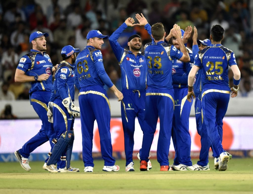 Mumbai Indians players celebrate fall of a wicket during an IPL match between Sunrisers Hyderabad and Mumbai Indians at Rajiv Gandhi International Stadium in Hyderabad, on April 18, 2016.